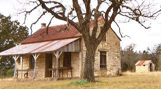 Grapetown stone schoolhouse with tree, Texas