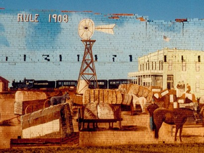 Rule Texas mural with windmill, cotton, train and horses